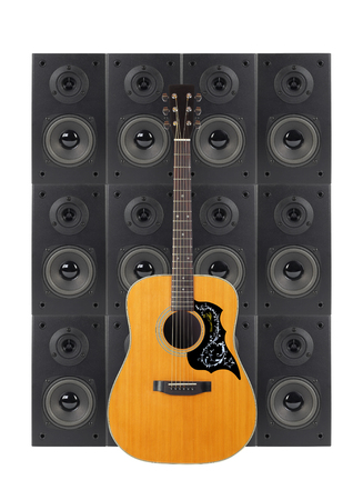 Music and sound - Folk guitar on a loudspeaker enclosure background. Isolated