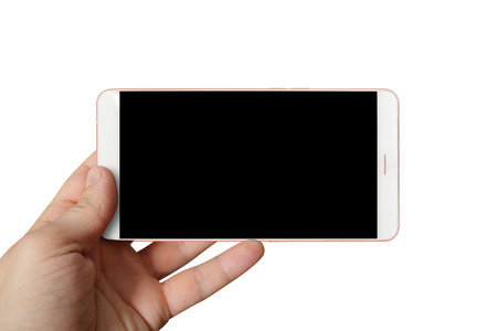 Modern Phones - modern big white mobile phone in a hand with the big touch screen isolated on a white background. Imagens