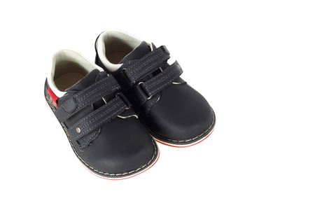 Clothes, shoes and accessories - Children black shoes on a white background. It is isolated, the worker of paths is present. Imagens