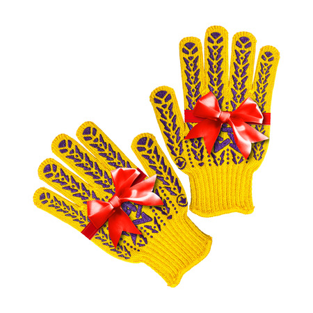 Construction, repair, tools - Gift yellow working gloves a red bow tied on a white background. It is isolated, the worker of paths is present.