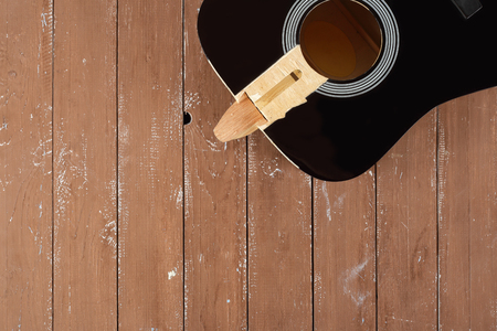 Guitar repair and service - broken sound board acoustic guitar top view wooden background