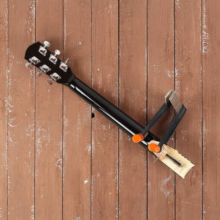 Guitar repair and service - Clamping a guitar neck top view wooden background Imagens
