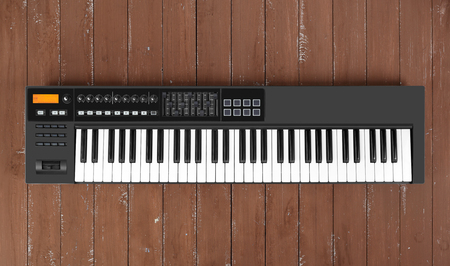 Musical instrument - Closeup MIDI piano 61 key keyboard on a wooden background