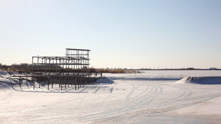 Winter boats parking - Construction Berth snow sky blue backgraund