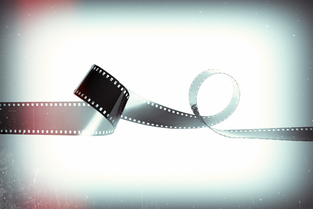Empty monochrome film from the analog camera on a retro style background