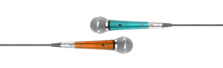 Music and sound - Vintage orange and blue vocal microphone isolated on a white background.