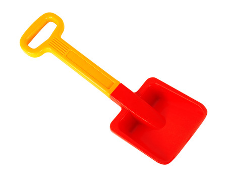 Tools Building and repair - Yellow red toy shovel with a handle on a white background. It is isolated, the worker of paths is present. Imagens