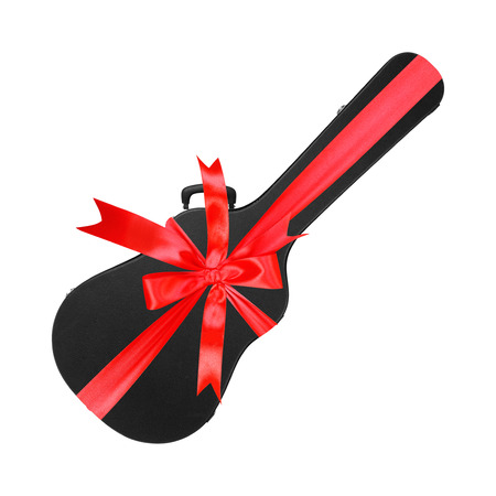 Musical instrument - Black acoustic guitar hard case gift tied red bow on a white background. Isolated