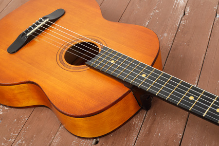 Musical instrument - Fragment retro classic russian soviet acoustic guitar on a wooden background Imagens