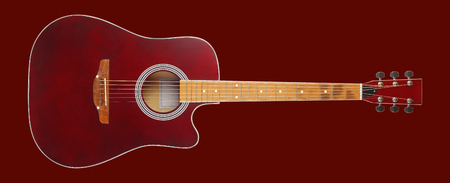 Musical instrument - Front view brown cutaway electric acoustic guitar on a red background. Isolated