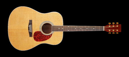 Musical instrument - Front view classic acoustic guitar isolated on a black background.