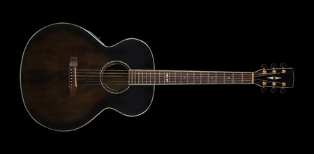 Musical instrument - Top view brown acoustic guitar on a black background. Isolated