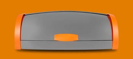 Kitchen capacities - Aluminium breadbox with orange sides on a orange background. Isolated Imagens