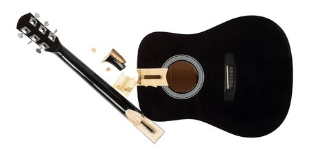 Guitar repair and service - broken sound board and neck acoustic guitar top view isolated white background
