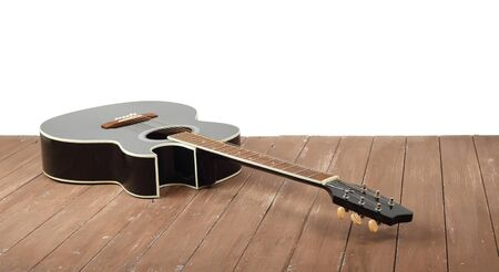 Musical instrument - Classic acoustic cutaway; cutaway guitar on a white wall background and wooden floor.
