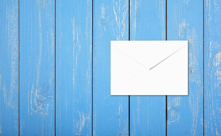 Postage and packing service - Top view Envelope on a blue wood plank background. Stock Photo