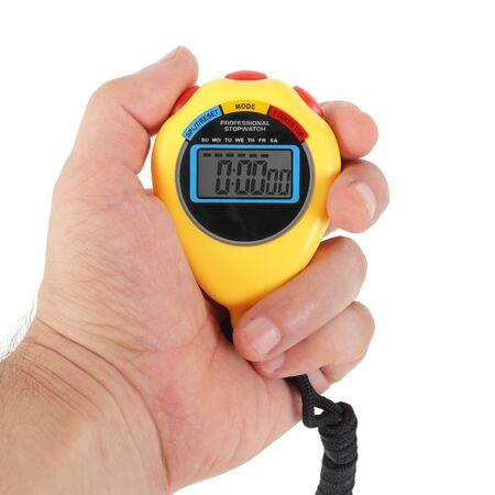 Equipamiento deportivo - Cronómetro electrónico digital amarillo en una mano sobre un fondo blanco. Aislado Foto de archivo