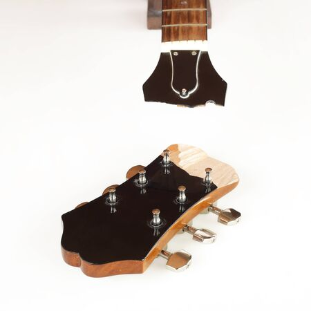 Guitar repair and service - Broken Headstock acoustic guitar white background