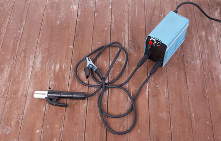 Industrial tool - Welding machine on a wooden background 스톡 콘텐츠