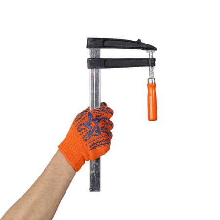 Objects hands action - Hand in working glove holds F-clamp speed clamp isolated white background.