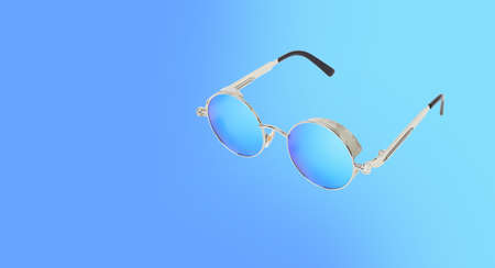 Clothes, shoes and accessories - Sunglasses isolated on a blue background. 免版税图像