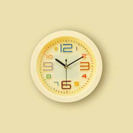 Alarm Clock - Yellow alarm clock isolated on a yellow background.