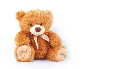 Toys - Baby teddy bear sits on white background 免版税图像