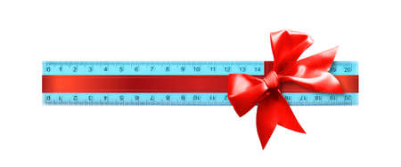 Science and education - Plastic blue school ruler gift tied red bow isolated on a white background.