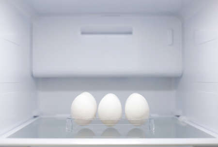 Home appliance - Six eggs Inside open two-door white refrigerator