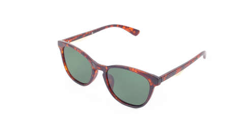 Clothes, shoes and accessories - Brown modern sunglasses with green lenses on a white background. 免版税图像