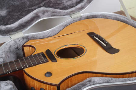 Musical instrument - Closeup fragment Broken acoustic guitar in hard case Standard-Bild