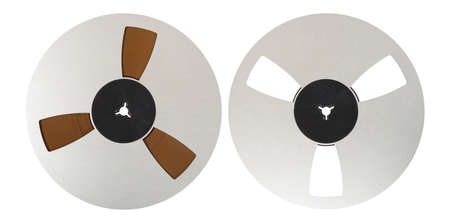 Vintage Music and sound - Two closeup Aluminum reel Magnetic tape isolated white background.