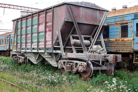 Transport - old Freight car and passenger railroad cars train with the broken windows.