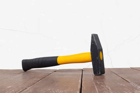 Tools Building and repair - Big hammer on a wooden and white wall background. Reklamní fotografie