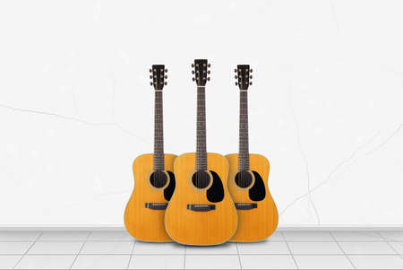 Home interior - Three acoustic guitar in front on a white wall background