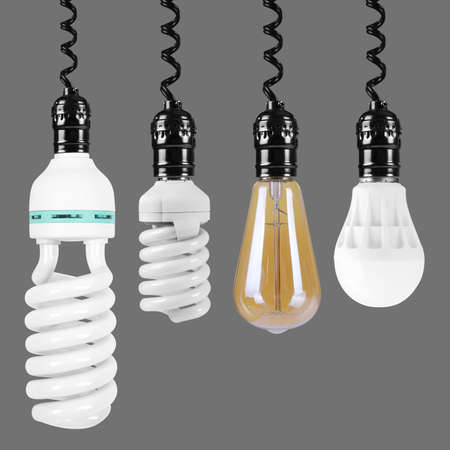 Electrical grid - Set Energy saving, led and Incandescent light bulb lamps down on top on a gray background. It is isolated, the worker of paths is present.