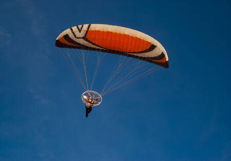 paraglider: Paraglider - Paraglider flying to the blue sky