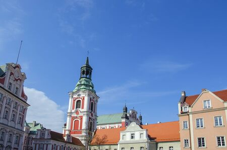 OLD TOWN, VIEW OF THE COLLEGIATE - A warm sunny day in the old town square in Poznan Collegiate Stock Photo