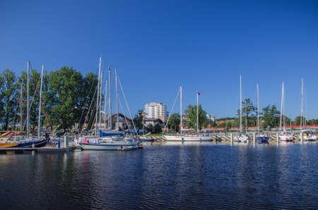 shrouds: Marina Solna in Kolobrzeg - View of the blue marina in Kolobrzeg. Yachts moored along the quays. Stock Photo