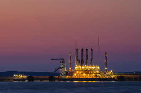lng: LNG TERMINAL AT NIGHT. Device for pumping gas from the tanker to the big tanks gas terminal in Swinoujscie