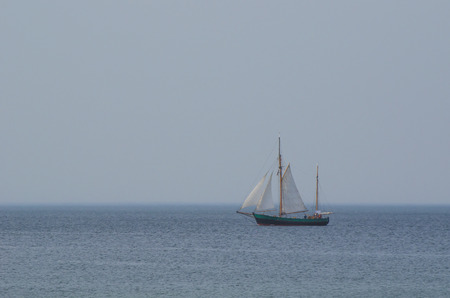 ketch: SAILING ON THE BALTIC SEA. Boat type gaff ketch in the open sea. Holiday cruise sailing on the Baltic Sea