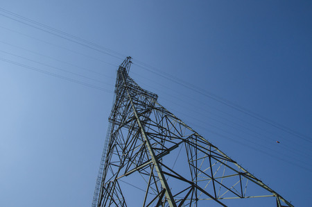 isolators: TOWER TRUSS. High-voltage line fastened on a great tower truss Stock Photo