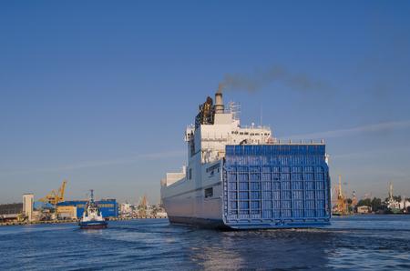 the entering: CARGO SHIP ENTERING PORT OF GDYNIA Stock Photo
