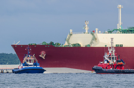 lng: LNG TANKER, TUG AND fireboat. Gas carrier at the wharf gas terminal in Swinoujscie.