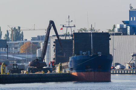 unloading: UNLOADING SHIP Stock Photo