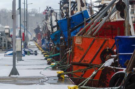 trawl: KOLOBRZEG - FISHING BOATS MOORED AT THE WHARF Stock Photo