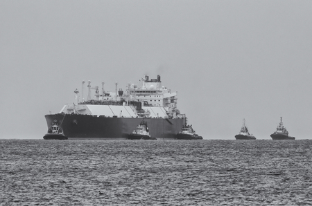 GAS CARRIER, ESCORTED BY TUGS