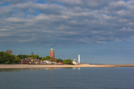 LIGHTHOUSE IN KOLOBRZEG - Sea coast at sunrise
