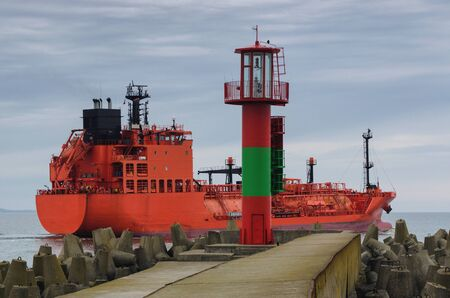 superstructure: RED LPG TANKER - The red ship sails into the sea
