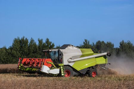 plowing: HARVEST- Agricultural machine on the field